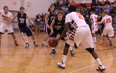 Boys basketball team loses league rival game