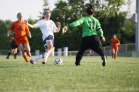 Sophomore Abby Sieperda slips past the Bonner Springs defence on the teams final game on Thursday, May 10. Mill Valley went on to beat the Braves 8-0.
