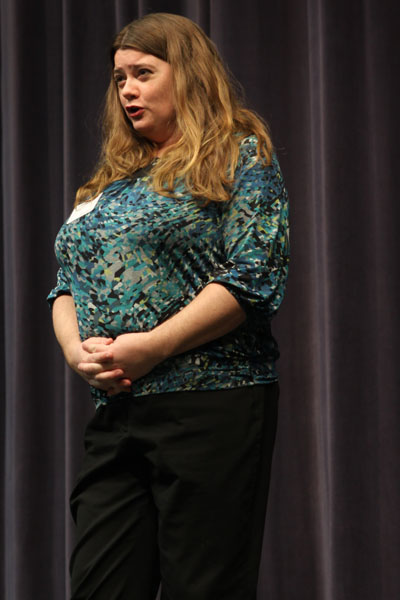Opera singer performs for choir and band students