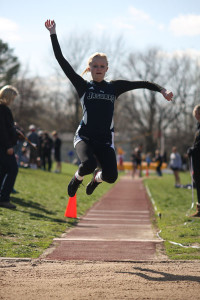 Sophomore Holly Webb competes in the long jump at the Shawnee Mission West Invitational on Friday, April 12.