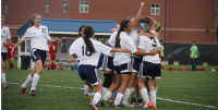 The girls soccer team celebrates their advancement to the state semi-finals at Mill Valley High School on Tuesday, May 21. The girls will play on Friday, May 24 against Valley Center High School in McPherson.