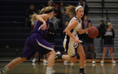 Girls basketball team loses first game to Piper High School