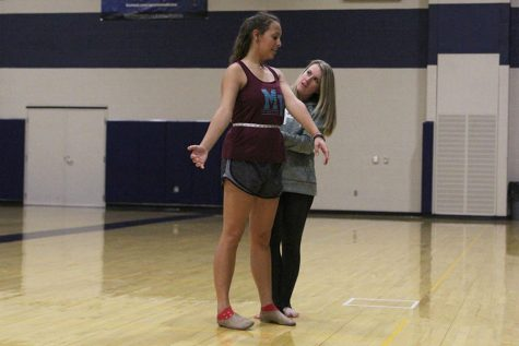 New assistant dance coach pushes Silver Stars to work harder, perform better