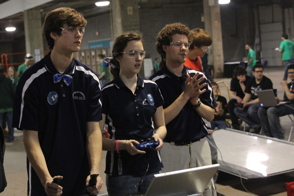 Senior Ryan Hannah and junior Megan Ring practice maneuvering their robot around the practice arena.