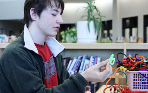 Senior Franklin Reitz creates models using pipe cleaners