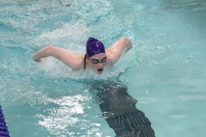 Girls swim at first meet in school history