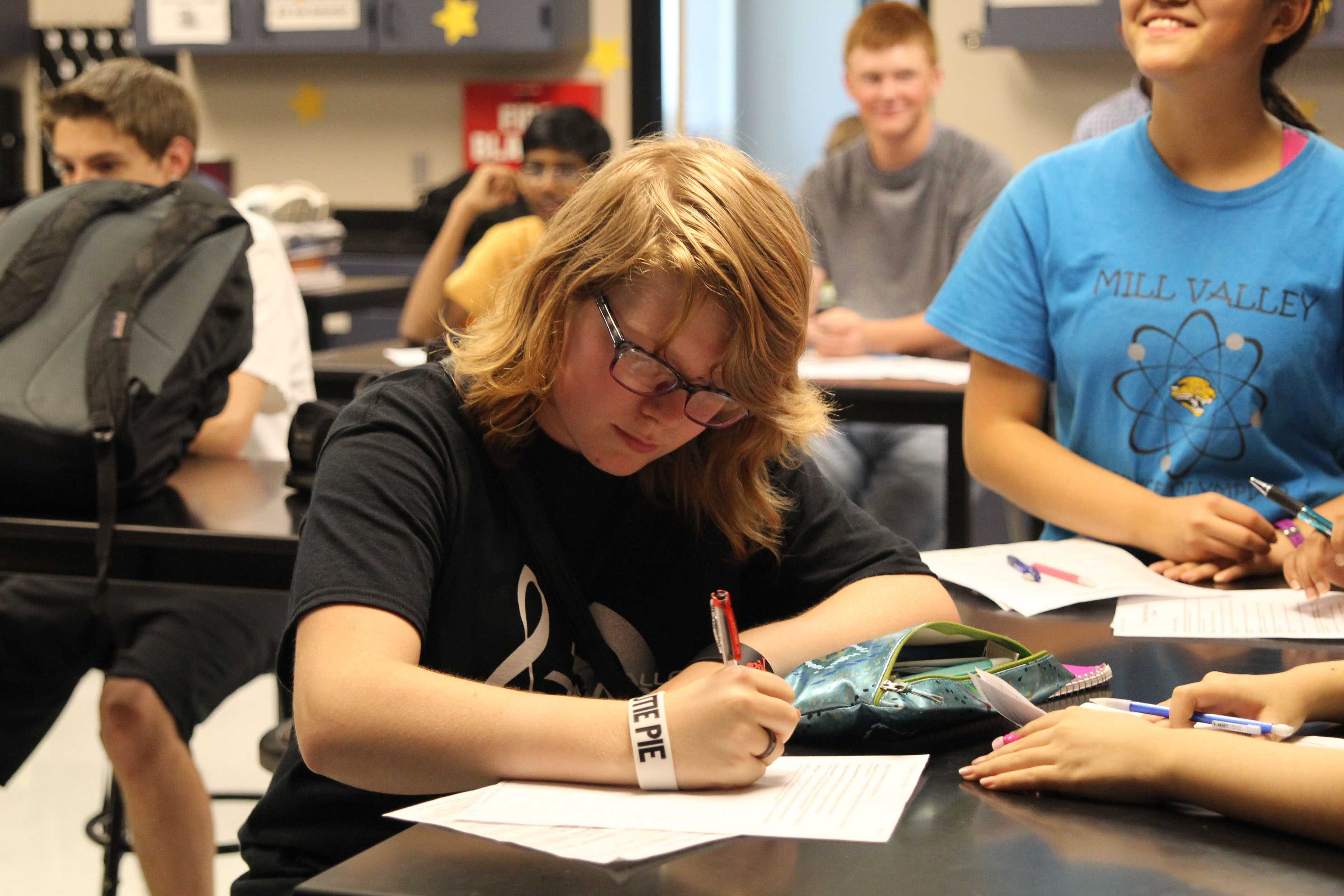 Junior Chari Pierce takes notes in preparation for the upcoming season of Science Olympiad.