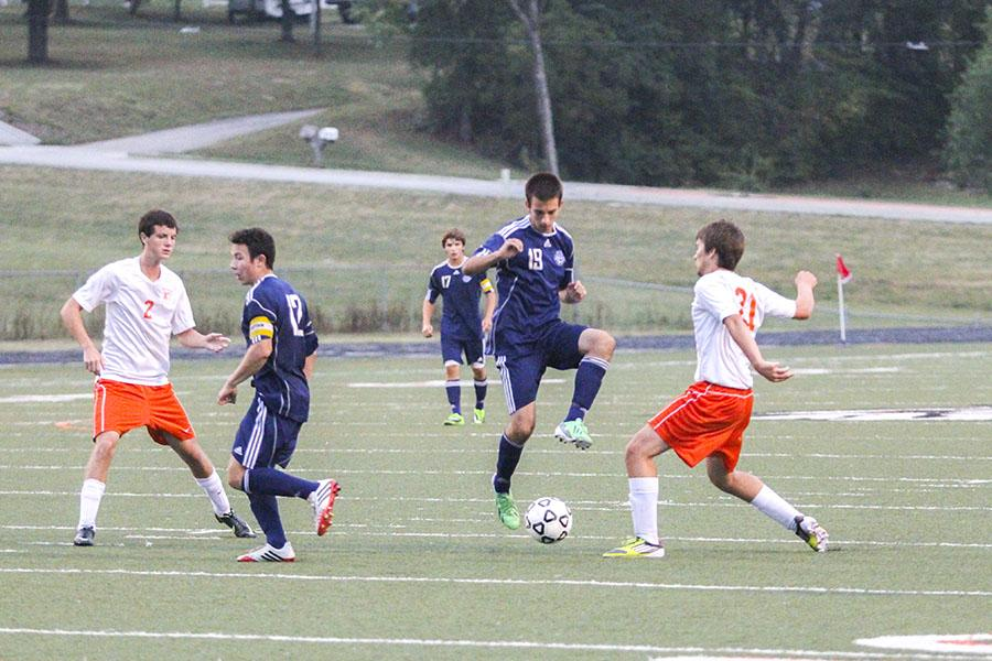 Senior+Zach+Huston+attempts+to+steal+the+ball+from+an+opponent+in+the+Sept.+16+soccer+game+against+the+Braves+at+Bonner+Springs+High+School.+