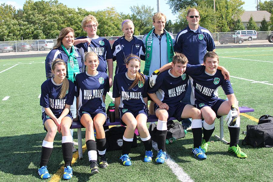 The Mill Valley Unified soccer team poses with Sporting Kansas City defender Seth Sinovic on Sunday, Oct. 20.