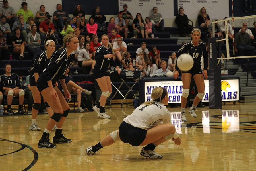 Senior+libero+Abby+Ford+dives+to+make+a+pass+in+the+Jaguar%27s+game+against+Lansing+on+Tuesday%2C+Oct.+8.+The+Jaguars+won+all+three+sets.