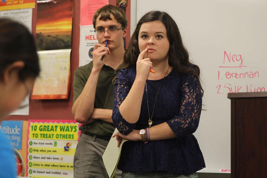 While+practicing+for+the+debate+at+Lansing+High+School+on+Saturday%2C+Nov.+2%2C+senior+Meghan+Fuller+listens+to+a+classmate%27s+opposing+statement.+%0A