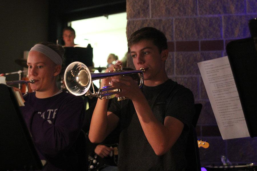 Playing+trumpet+in+the+pit%2C++junior+Eric+Marquardt+practices+for+the+school+musical+on+Tuesday%2C+Nov.+5.