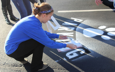 Building improvement committee members of Student Leadership Team finish their new parking spot on Tuesday, Dec. 3.