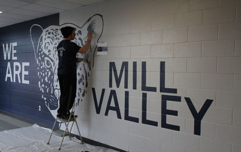 """NAHS vice president Steven Blaine puts a few finishing touches on the new mural in the C-wing on Thursday, Jan. 16. """"The actual painting was hard, but when you finish it, it all just makes it worth while,"""" Blaine said."""