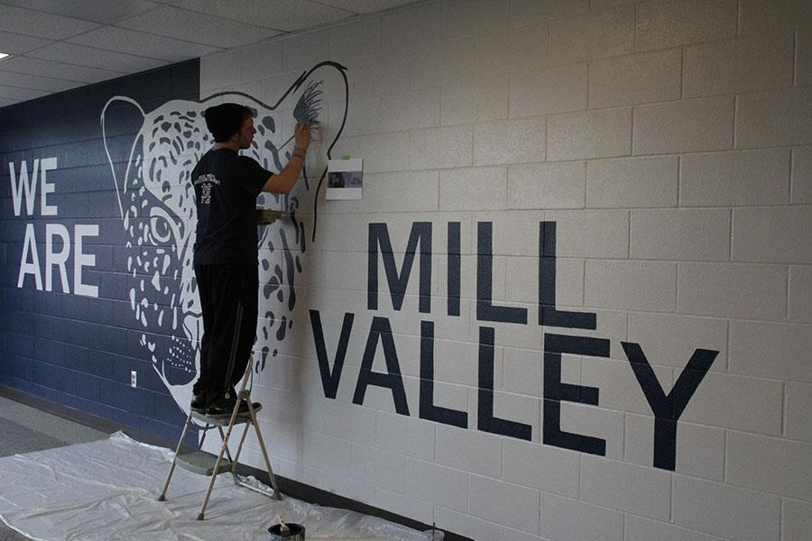 NAHS+vice+president+Steven+Blaine+puts+a+few+finishing+touches+on+the+new+mural+in+the+C-wing+on+Thursday%2C+Jan.+16.+%E2%80%9CThe+actual+painting+was+hard%2C+but+when+you+finish+it%2C+it+all+just+makes+it+worth+while%2C%E2%80%9D+Blaine+said.