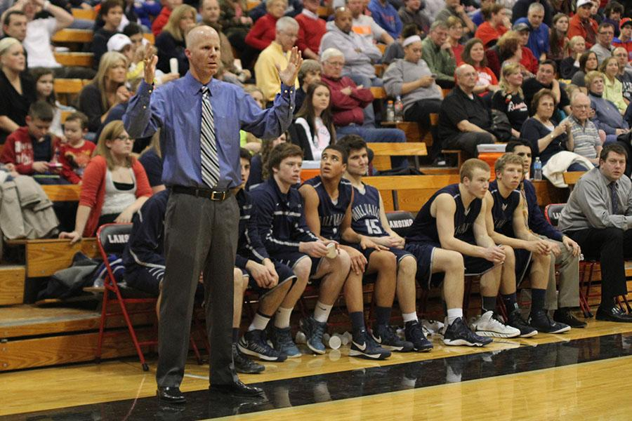 Head+boys+basketball+coach+Justin+Bogart+resigns+after+14+years+of+coaching+on+Friday%2C+March+28.
