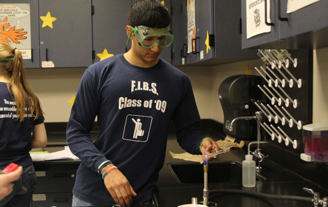 Students work to test chemical reactions to fire on Tuesday, March 11.
