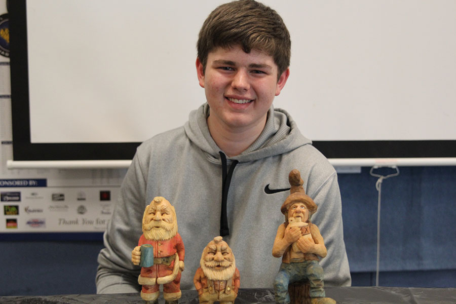 Displaying his original wooden carvings, freshman Austin Snyder spends his free time delicately carving and painting his handmade figurines.