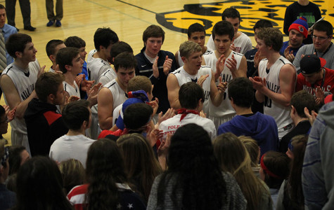 Members of the basketball team celebrate their 67-53 win over Topeka Seaman in the first round of the sub-state tournament on Wednesday, March 5. The team will play at Lansing on Friday, March 7 for the sub-state championship.