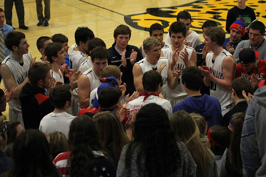 Members+of+the+basketball+team+celebrate+their+67-53+win+over+Topeka+Seaman+in+the+first+round+of+the+sub-state+tournament+on+Wednesday%2C+March+5.+The+team+will+play+at+Lansing+on+Friday%2C+March+7+for+the+sub-state+championship.