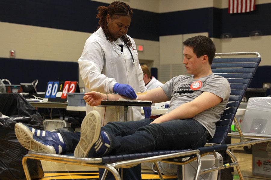 Following+his+blood+donation%2C+junior+Austin+Isern+is+sanitized+and+bandaged.