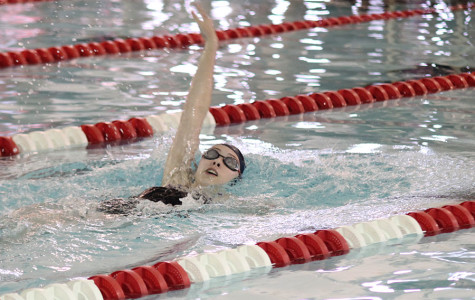 Members of girls swim team qualify for state in first meet of season