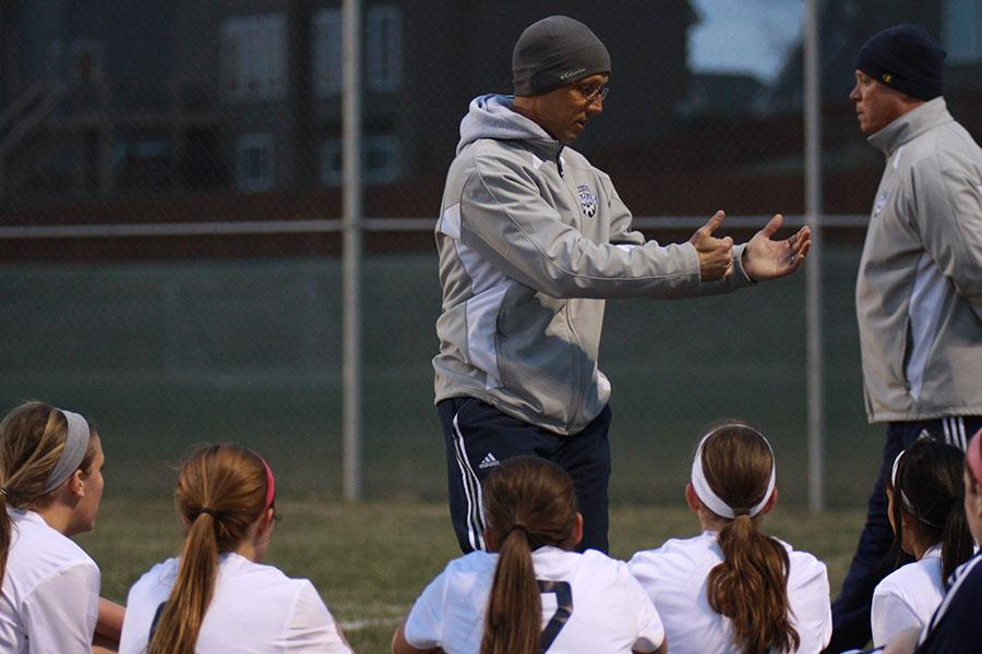 Head girls soccer coach Arlan Vomhof and his team prepare for another game.