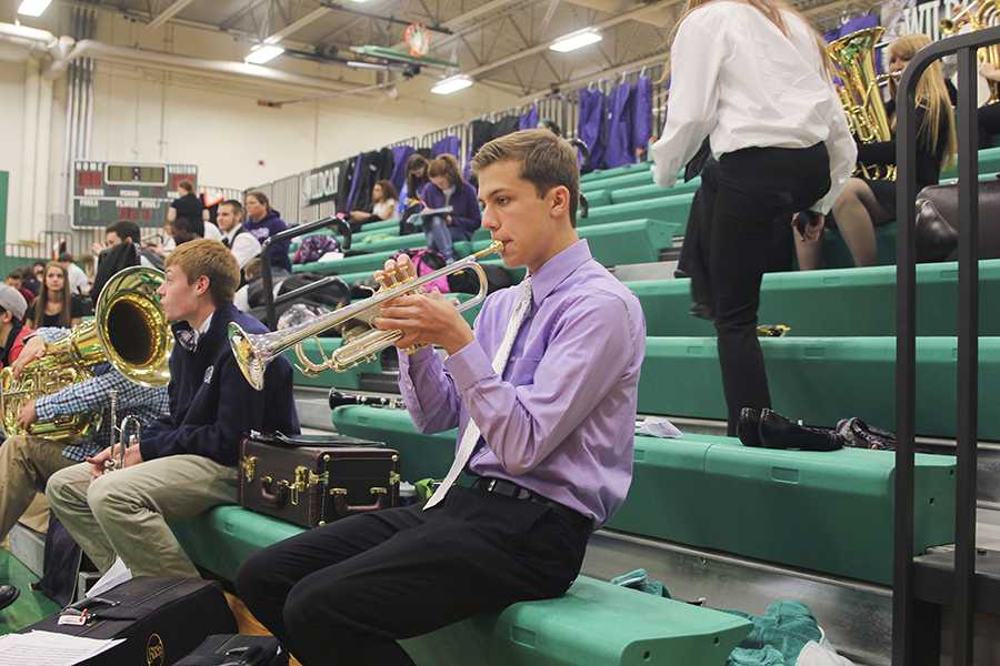 Junior Eric Marquardt prepares for his solo at the KSHSAA Music Festival in the auxilliary gym of De Soto High School on Saturday, April 5.