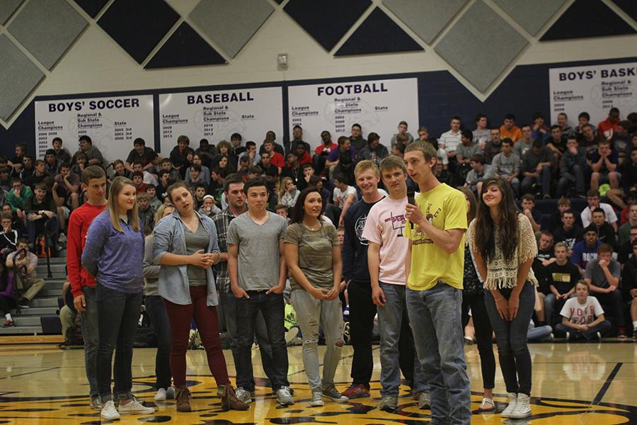In recognition of their nomination, senior prom candidates participate in a improvisational skit during a pep assembly on Tuesday, April 29.