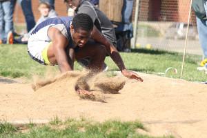 Junior varsity track members compete in varsity meet