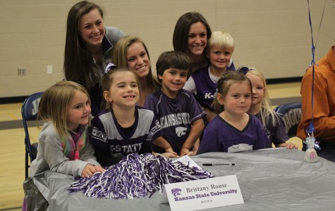 Senior Brittany Rouse signs to dance at Kansas State University surrounded by friends and family at a signing ceremony on Wednesday, April 30. Rouse is excited to meet new people not he team.