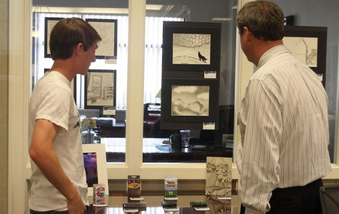 Students present their artwork at the Country Club Bank for an art show on Thursday, May 8.