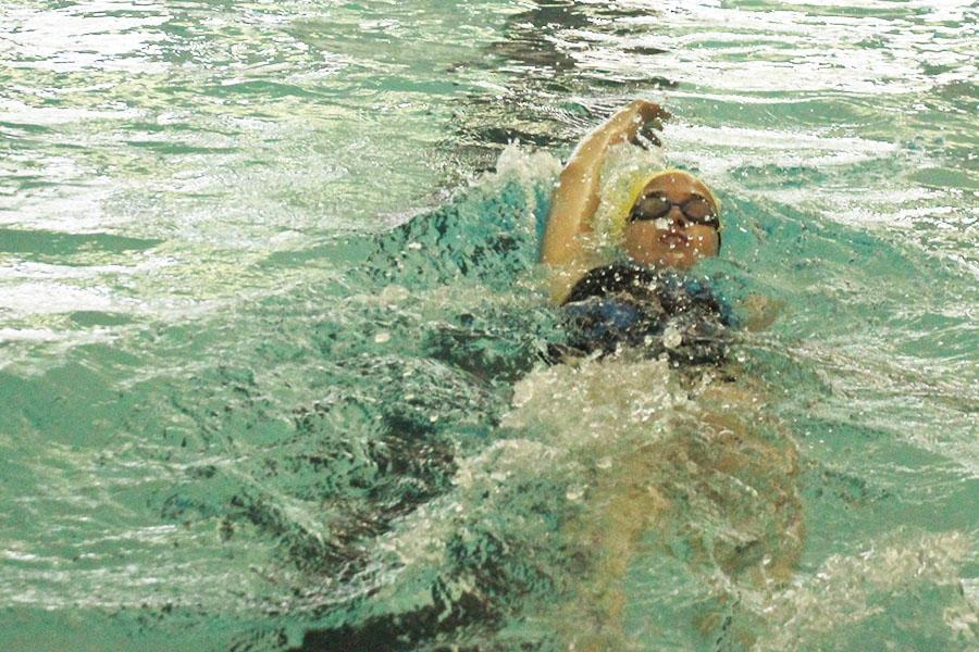 The+girls+swimming+team+places+second+at+the+last+regular+season+meet+on+Thursday%2C+May+1+at+Turner+High+School.+