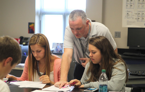 First year science teacher Chad Brown helps his students in Physics.