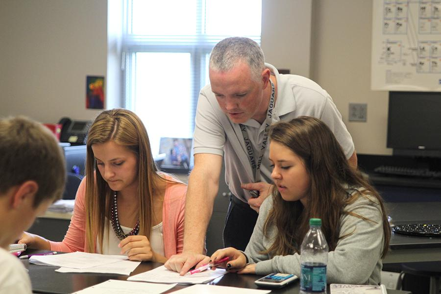 First+year+science+teacher+Chad+Brown+helps+his+students+in+Physics.+