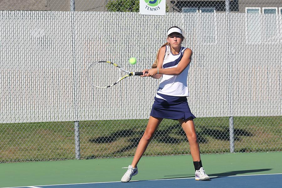 Sophomore+Lauren+Tracht+returns+the+ball+to+her+opponent+during+the+girls+tennis+meet+against+Blue+Valley+Southwest+on+Tuesday%2C+Oct.+7.+The+girls+fell+to+the+Timberwolves+1-8.+