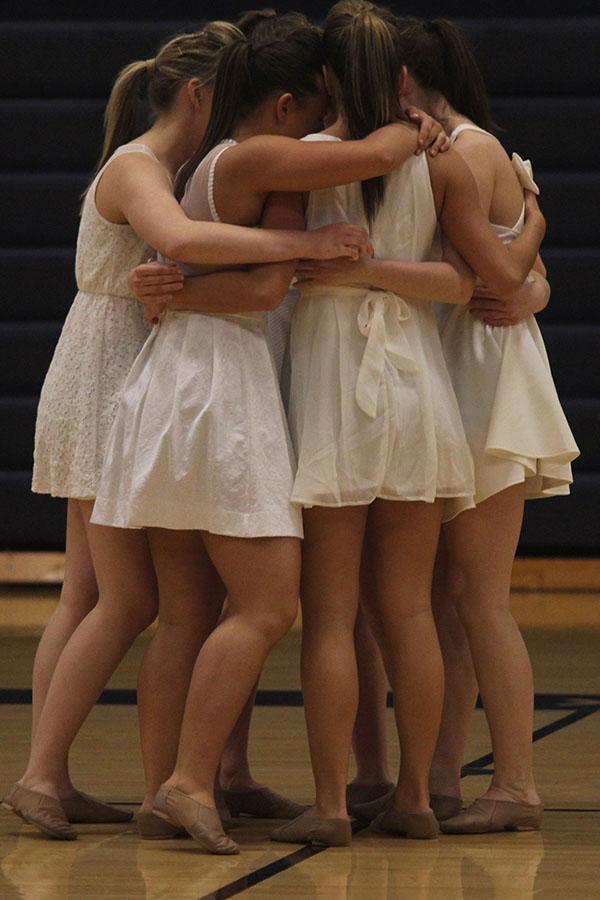 After+their+last+dance%2C+seniors+hug.+