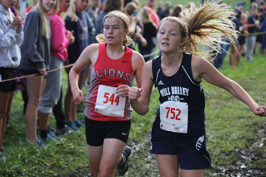 Freshman+Jenna+Walker+runs+ahead+of+her+opponent+at+the+end+of+the+Bonner+Springs+race+on+Saturday%2C+Sept.+17.