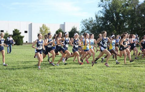 The girls varsity cross country team starts off strong during the 5000 meter race.