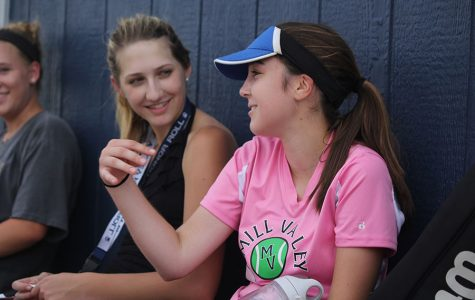 Between her games, junior Tori Benson tells junior Madison VanBuhler a story on Tuesday, Sept.  20.