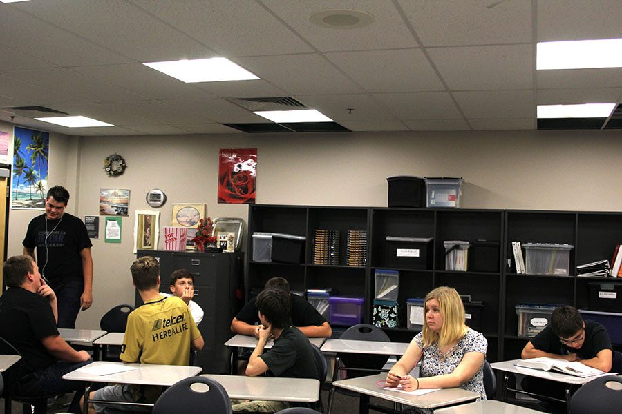 Students+in+Jeannette+Hardesty%27s+class+look+up+at+the+holes+in+her+room%2C+but+continue+normal+seminar+activities+despite+the+damage+in+the+ceiling.+