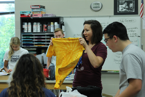 Stuco sponsor Erica Crist holds up a freshman homecoming t-shirt.