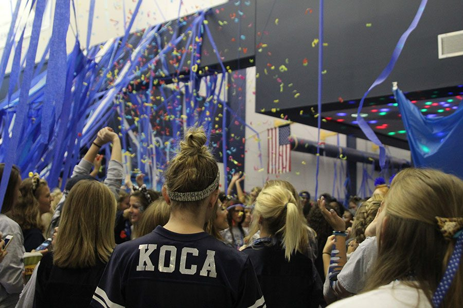As+senior+Mallory+Koca+stands+in+the+crowd%2C+confetti+erupts+around+her.