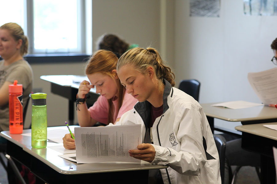 """While taking an AP Euro test, senior Meg Green and sophomore Josie Carey focus on selecting the right answers. """"I felt like I knew the material [on the test] very well,"""" Carey said."""