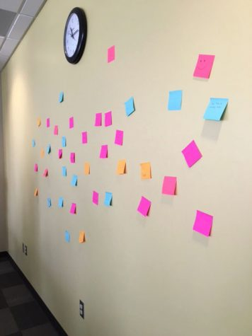 The people at the conference made a wall of sticky notes that had motivating messages on them to help lift the spirits of the others who were there.