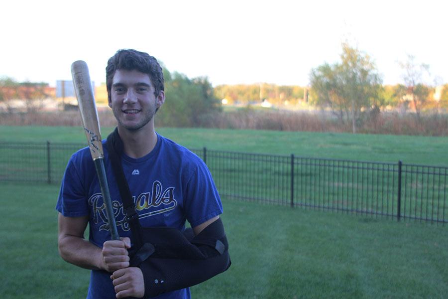 With his arm in a sling on Sunday Oct 16th, senior Luke Sosaya holds his baseball bat.