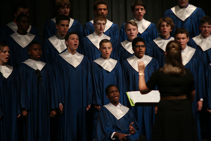 With the direction of choir teacher Stephanie Mooneyhan, the mixed choir sings during their first concert of the year on Thursday, Oct. 13.