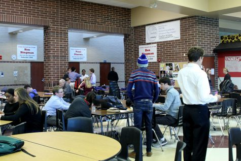 While waiting to go into their individual debates students from many different schools prepare in the commons.