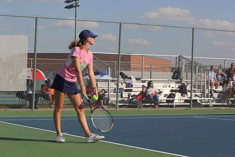 Winding+up+for+a+serve%2C+senior+Kaley+Muir+focuses+on+her+opponents+during+her+doubles+match+on+Monday%2C+Oct.+3.+At+its+last+regular+meet+of+the+season%2C+varsity+girls+tennis+went+6-2.