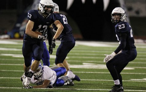 Football defeats Sumner Academy in first game of postseason